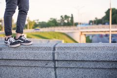 Man walking on the concrete railing of the bridge Stock Photography