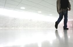 Man walking in corridor Stock Image