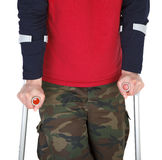 Man walking with a crutch Royalty Free Stock Image