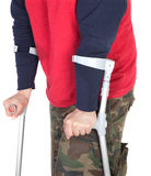Man walking with a crutch Royalty Free Stock Images