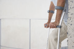 Man Walking With Crutches Royalty Free Stock Photo