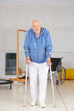 Man walking with crutches in physiotherapy Royalty Free Stock Images
