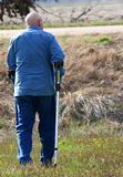 Man Walking with Crutches in Rural Setting Stock Photos