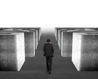 Man walking through 3d concrete maze Royalty Free Stock Photo