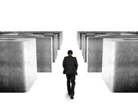 Man walking through 3D concrete maze Stock Photo