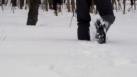 Man Walking in Deep Snow stock video footage