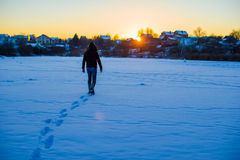 Man walking on deep snowy field Royalty Free Stock Images