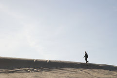 Man walking in desert Stock Photo