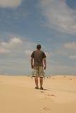 Man walking in desert Stock Images