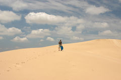 Man walking in desert Stock Photography