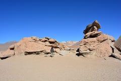Man walking in a desert of Bolivia Stock Image