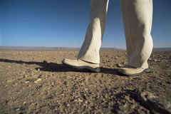 Man walking in desert, low section Royalty Free Stock Images