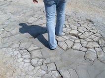 Man walking through desert stock photo