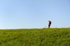 Man walking at dike Stock Image