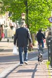Man walking dog. A man walking his dog in Amsterdam, The Netherlands Royalty Free Stock Image