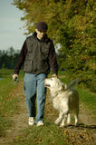 Man walking with dog Royalty Free Stock Photo