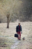 Man walking with dog Royalty Free Stock Image