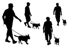 Man walking with a dog Royalty Free Stock Images
