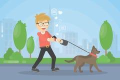 Man walking dog. Royalty Free Stock Image