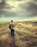Man walking down country road. On the praires Stock Photography