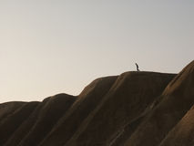 Man walking down a hill. A, what lookes like, a burdened man walking down a hill Stock Photography