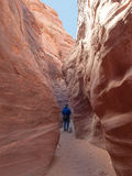 Man walking down narrow canyon Royalty Free Stock Images