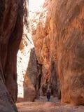 Man walking down narrow canyon Royalty Free Stock Image