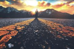 Man walking down road royalty free stock photos