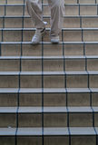 Man walking down stairs. Legs of man walking down stairs royalty free stock photography
