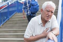 Man walking down stairs. Senior weak men is walking down stairs royalty free stock photo