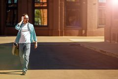 Man walking down the street royalty free stock images