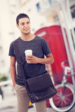 Man walking and drinking coffee in city Royalty Free Stock Photos