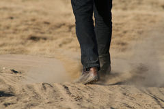 Man walking through dust Stock Photography