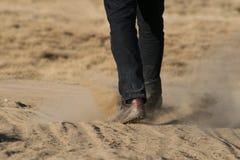 Man walking through dust Stock Photography