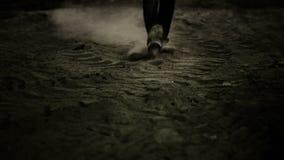 Man walking in dust stock footage