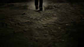 Man walking in dust stock video footage