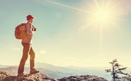 Man walking on the edge of a cliff. High above the mountains Royalty Free Stock Photos