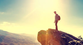 Man walking on the edge of a cliff Stock Photography