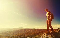 Man walking on the edge of a cliff Stock Photos