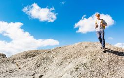 Man walking on the edge of a cliff Royalty Free Stock Image