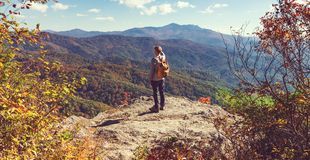 Man walking on the edge of a cliff Royalty Free Stock Photo