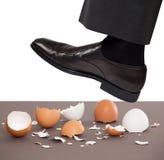 Man walking on egg shells Stock Photos