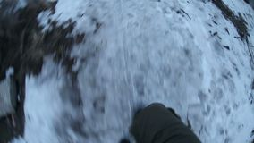 Man walking escapes pursuit fear the snow and dry stock video footage
