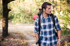 Man walking in forest with marching backpack Royalty Free Stock Image