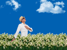 Man walking freely through a field of flowers. In a sunny day Royalty Free Stock Photography