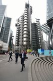 Man walking in front of lloyds building Stock Image