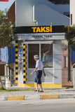 Man walking in front of a taxi office in Izmir Turkey Stock Photography