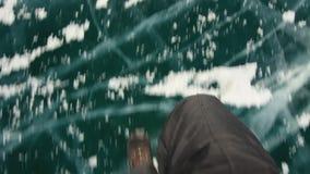Man walking on the frozen Lake Baikal. stock video footage