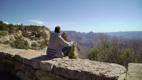 Man walking in Grand Canyon. Near cliff stock video