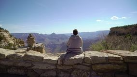 Man walking in Grand Canyon. Near cliff stock footage